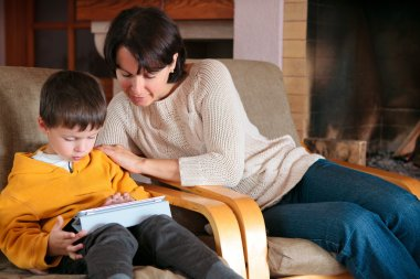 Mother and son playing on digital tablet PC