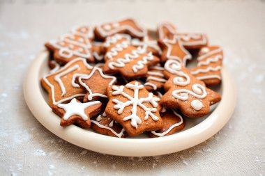 Plate of christmas cookies with festive decoration