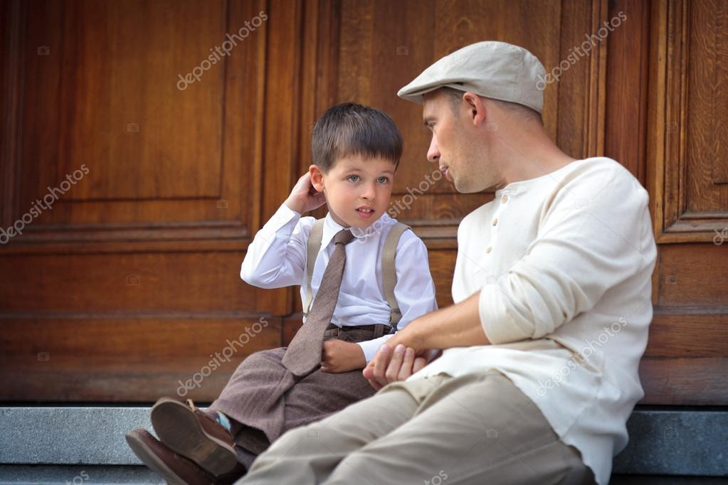 Happy father and son relaxing outdoors in city