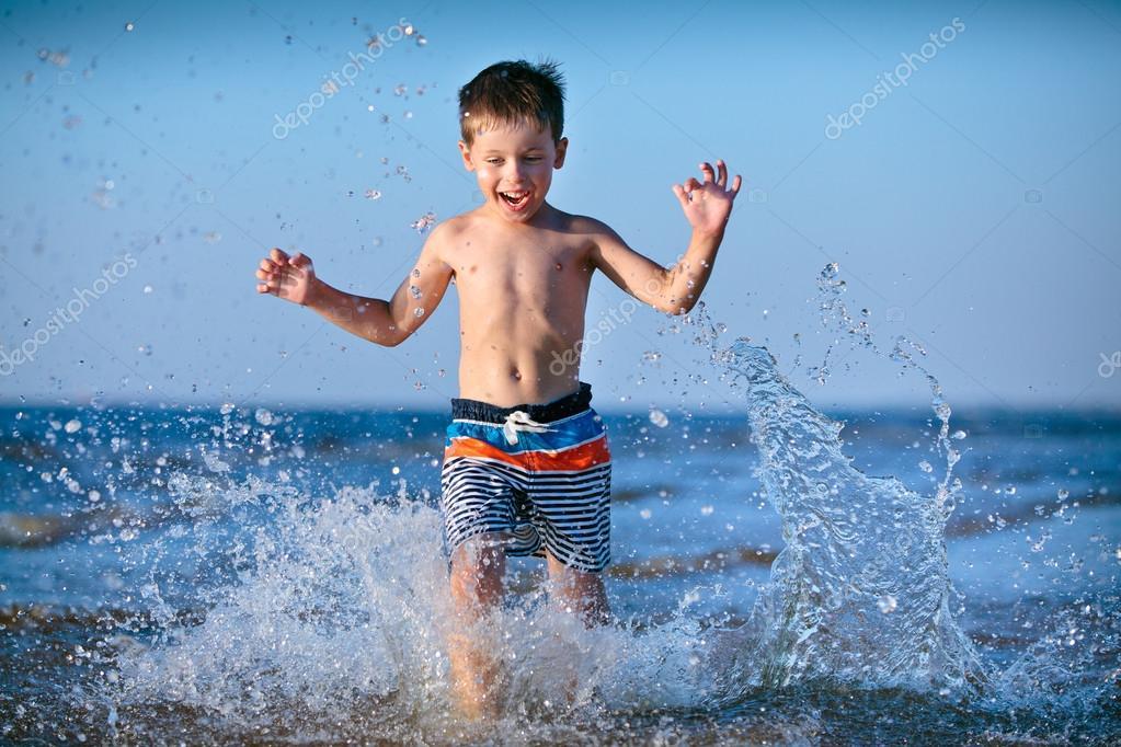 Cute little boy having fun at the beach