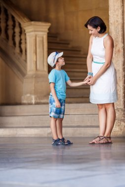 Mother and son talking at Alhambra palace
