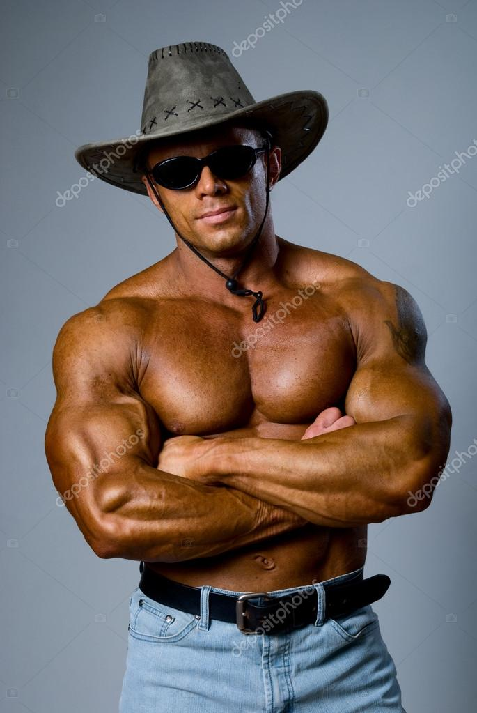 Handsome muscular man with a hat