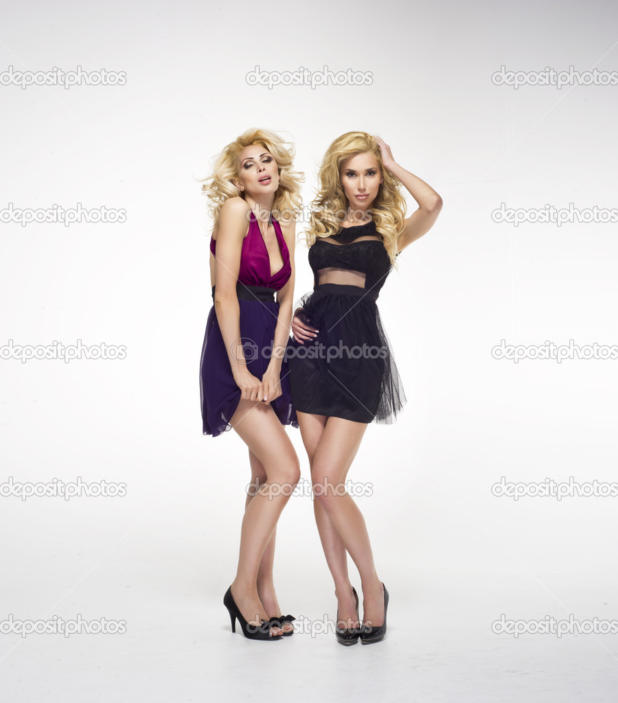 33aa3f8ed Two sexy women wearing mini skirts — Stock Photo © aarrttuurr #34589517