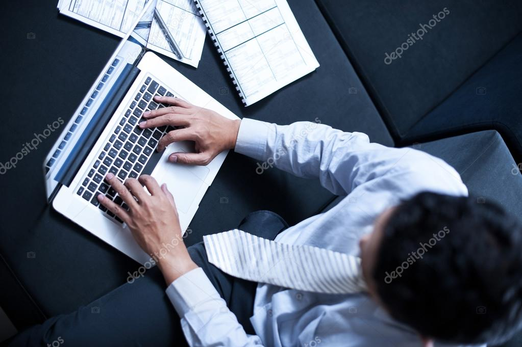 Asian business man working with laptop