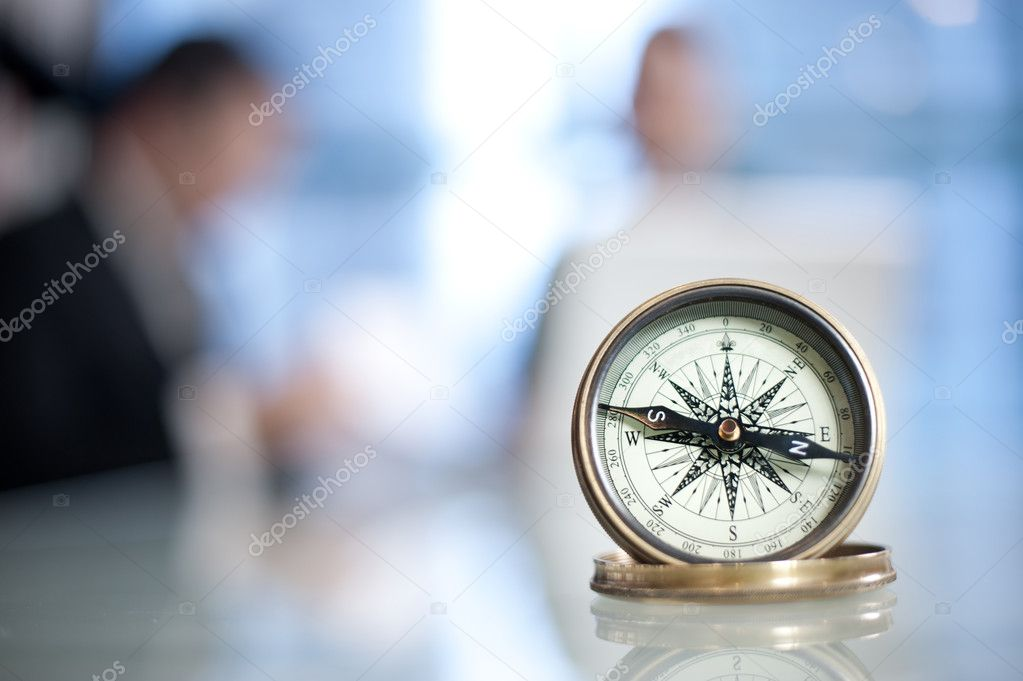 Compass on the meeting table