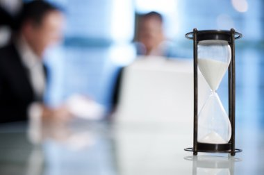 Hourglass on the meeting table