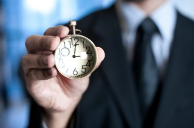 Hand of businessman with clock