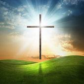Fotografie Christian cross on grassy background.