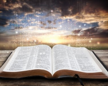 Glowing Bible at sunset