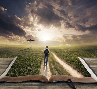 Man walking on a Bible towards a cross stock vector