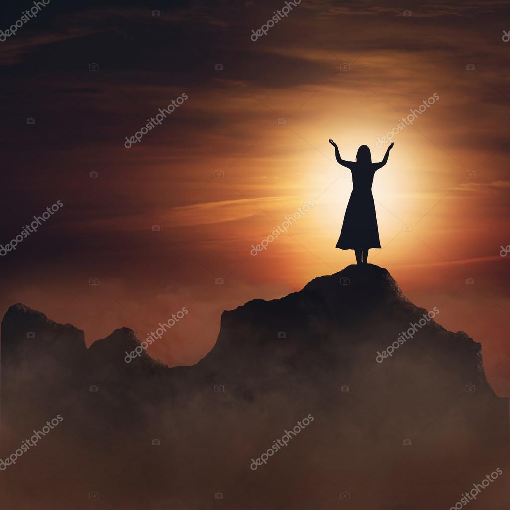 Woman on mountain.