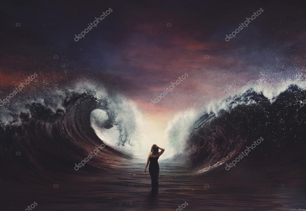 Woman walking through parted sea.
