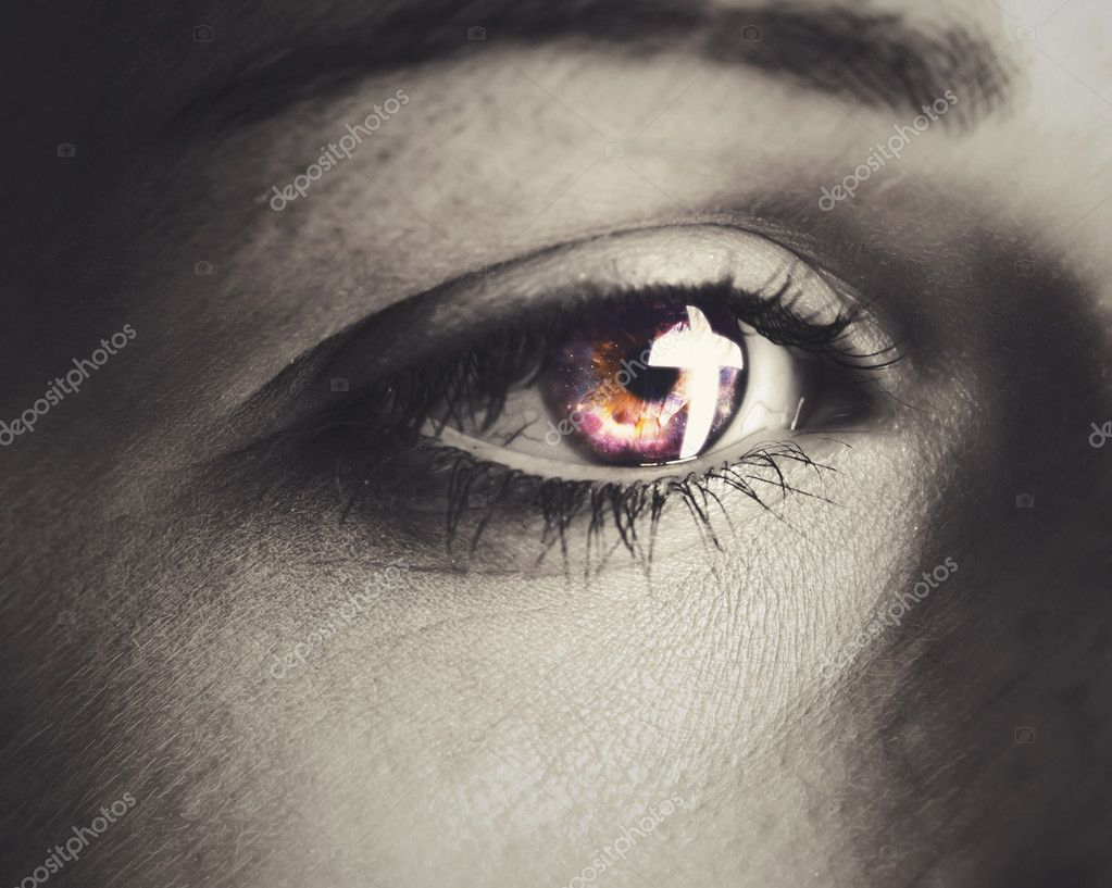 A woman's eye with a cross reflection