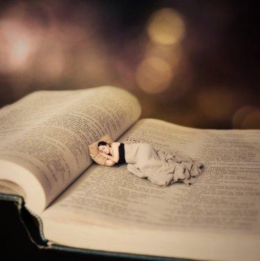 Woman sleeping on Bible.