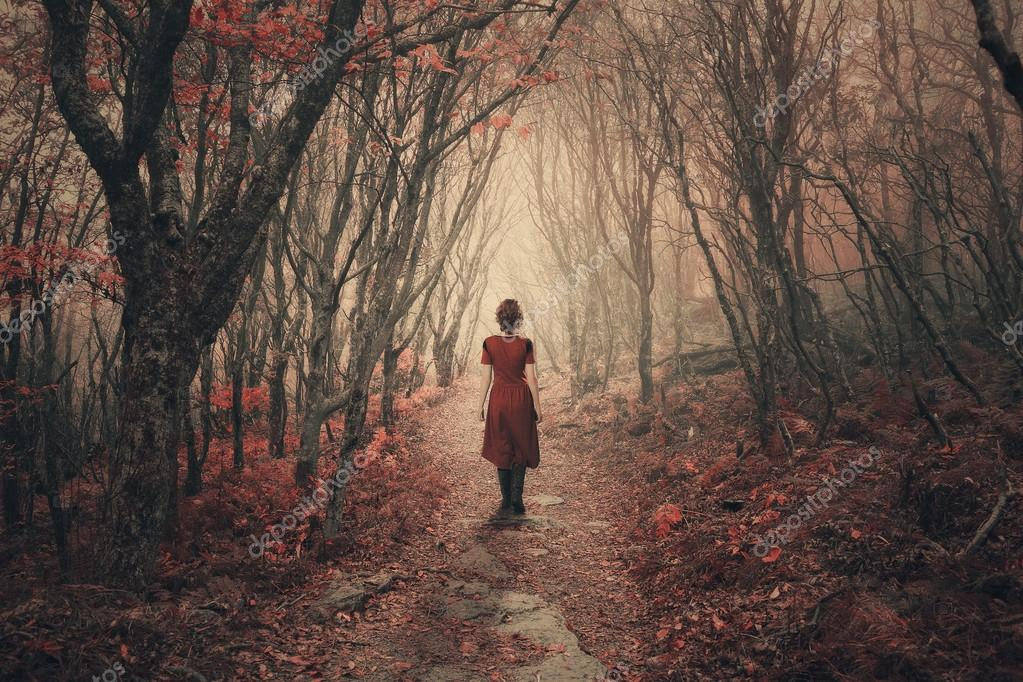 Woman and foggy forest.