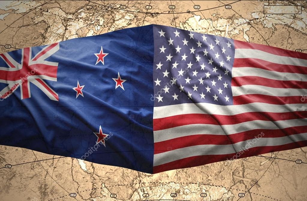 waving new zealand and american flags of the political map of the world photo by ruletkka