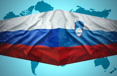 Waving Slovenian and Russian flags