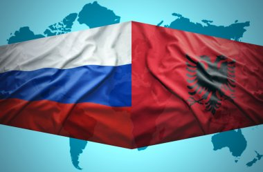 Waving Albanian and Russian flags