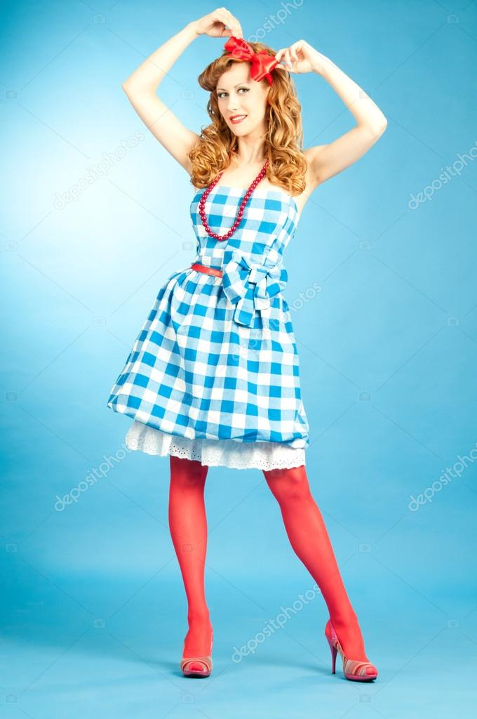 ecc3d3797b99f Pretty sexy redhead Pin Up girl in checkered dress and red stoc — Stock  Photo