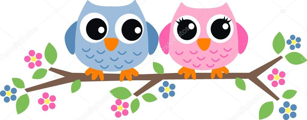 Two sweet owls sitting on a branch