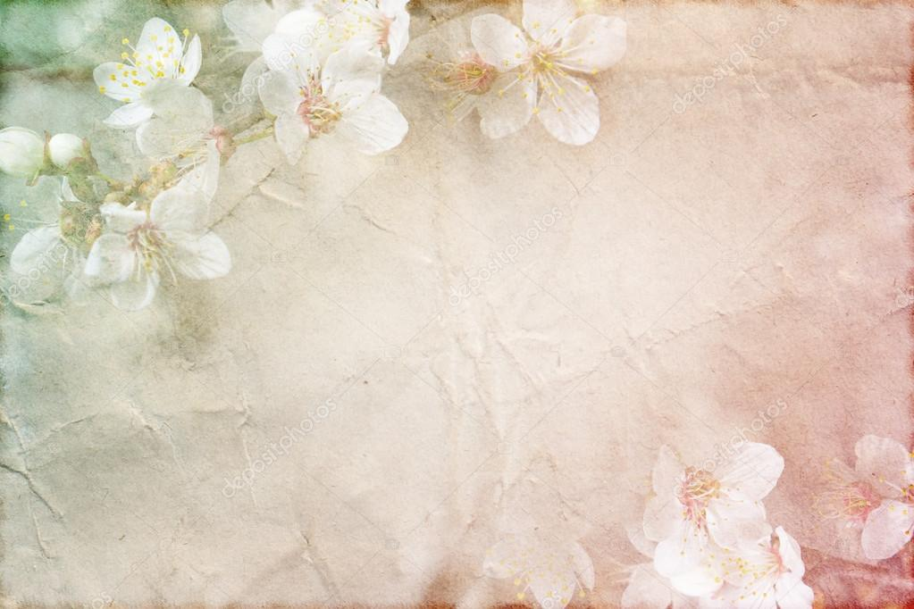 gentle spring grunge texture with flowers on old paper with pastel colors