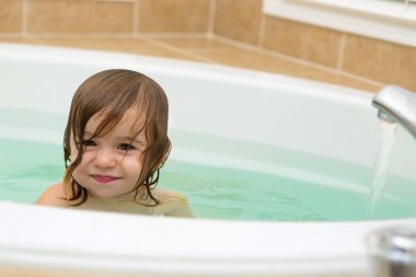 Cute Toddler Smiling satisfied from the Bath Tub