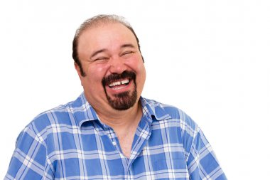 Joyful bearded Caucasian man laughing loud