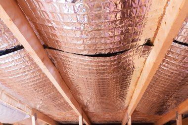 Reflective Radiant Heat Barriers Between Attic Joists Used as Ba