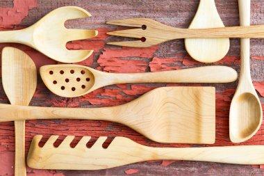 Still life arrangement of wooden kitchen utensils