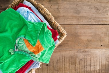 Clean unironed summer clothes in a laundry basket