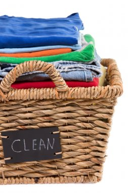 Washed fresh clean clothes in a laundry basket