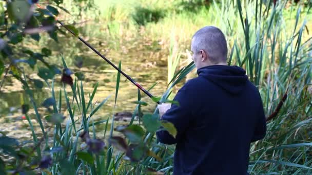 Man fishing near lake alone in summer episode 3