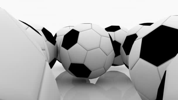 Fotbalové míče na bílé