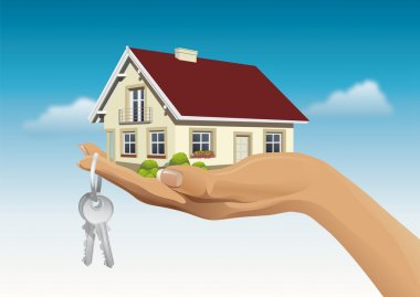 Miniature house on hand with keys