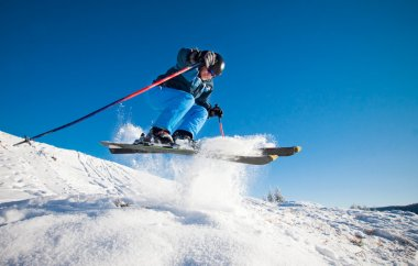 Man practicing extreme ski on sunny day