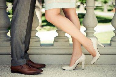 Couple legs kissing