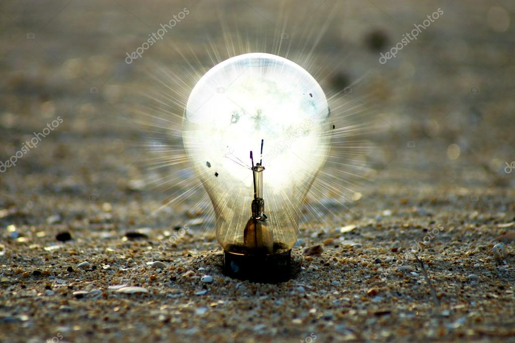 light bulb on the beach.