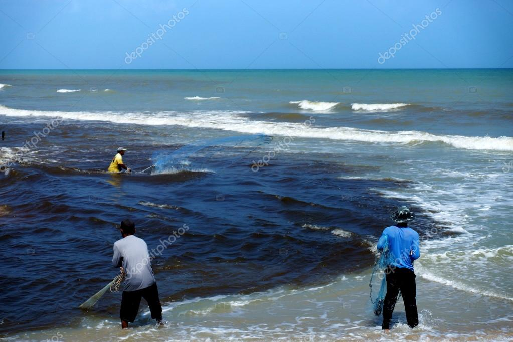 Casting fishermen in the Black Sea wastewater.