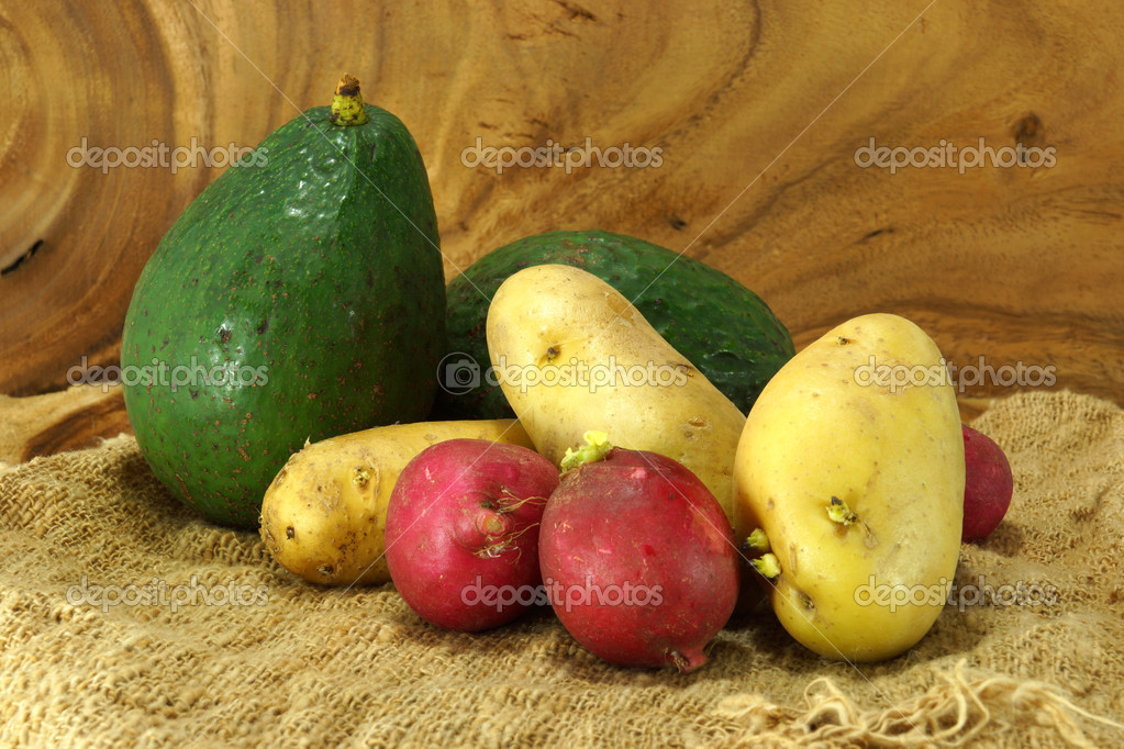 Vegetables and fruits on wooden background.
