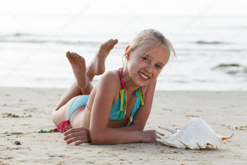 Little girl having fun on a beach