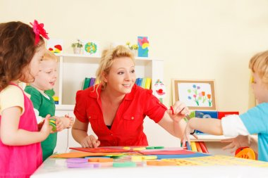 Preschoolers in the classroom with the teacher