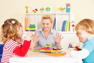 Teacher talking with children.
