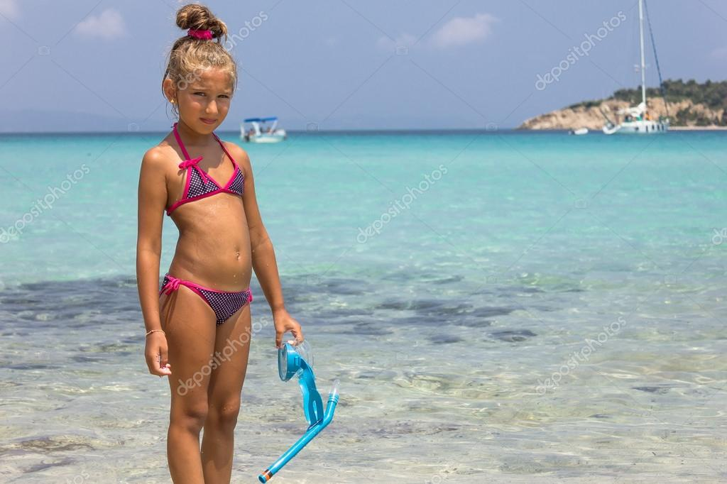 Girl with mask in the sea