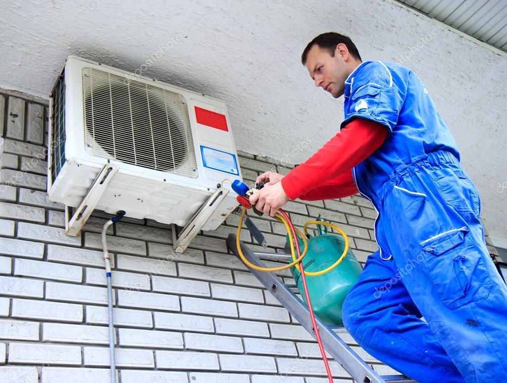 Air conditioner worker Stock Photo by vladislavgajic 29275597