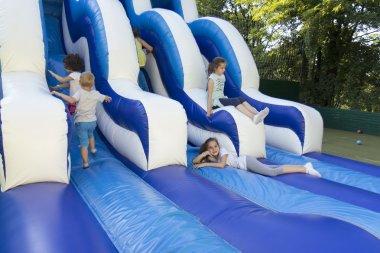 Girl on the trampoline slide