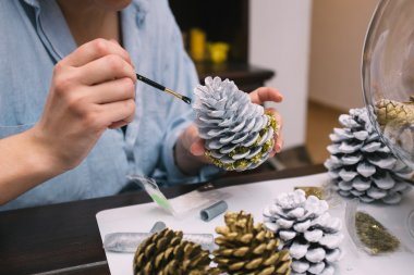 Woman making decorations for Christmas