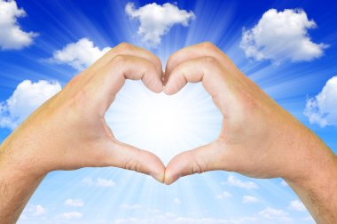 Hands in the form of heart.On the background blue sky stock vector