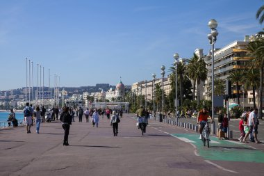 France , Cote d'Azur . Nice, October 16, 2013. View of the Promenade des Anglais sunny autumn day