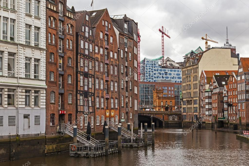 hamburg germany february 19 2013 view of the canal and old buildings warehouses and. Black Bedroom Furniture Sets. Home Design Ideas