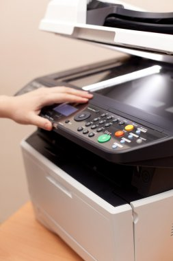 Woman's hand with open copier